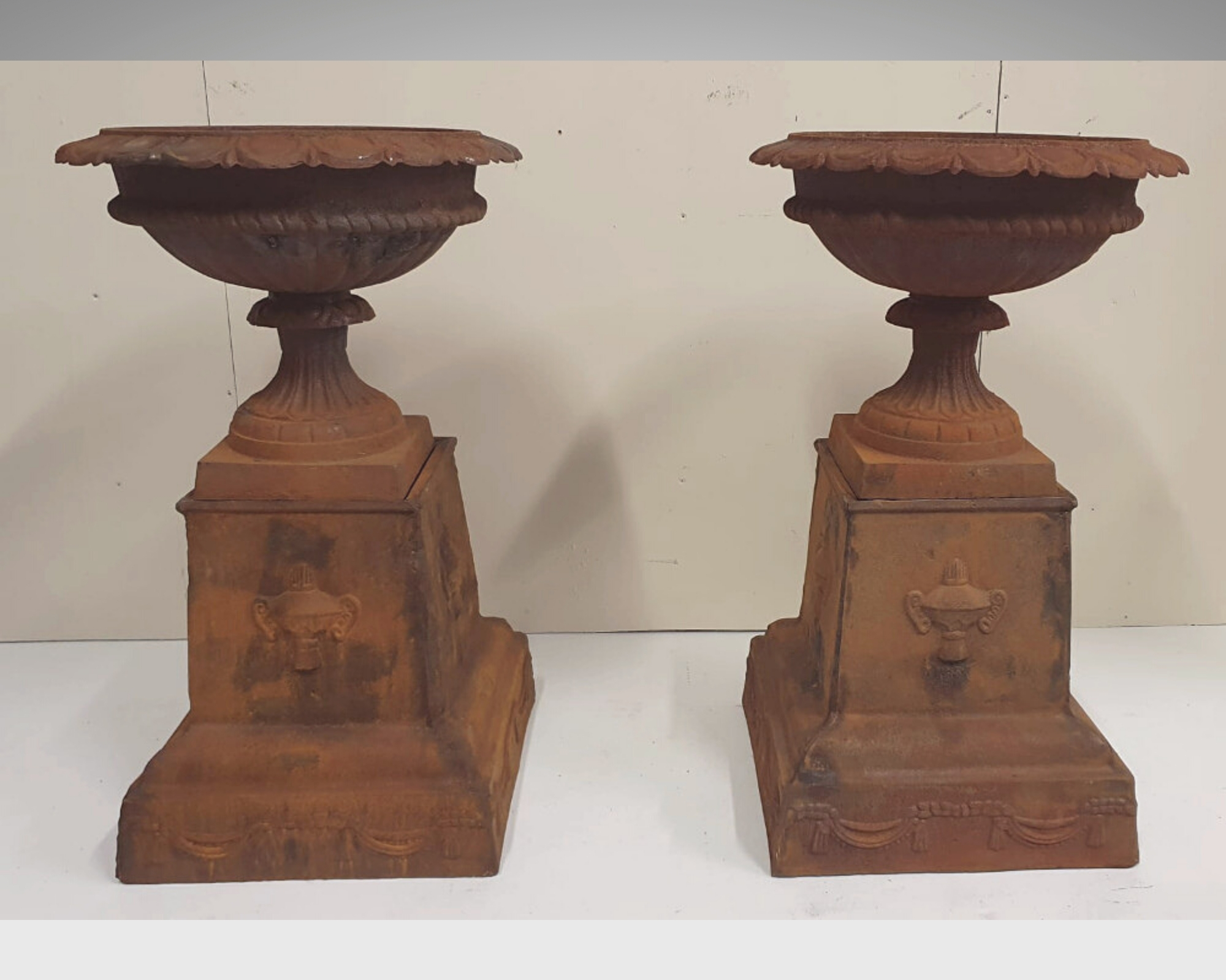 Pair of 20th Century Cast Iron Urns on Stands